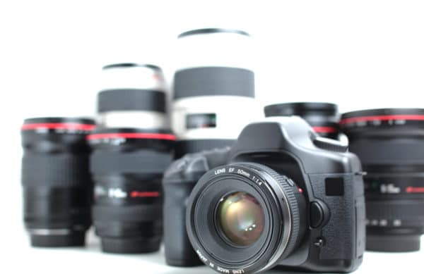 DSLR & Lenses  (Modern hi-end professional photographic equipment - a camera and lenses, isolated on white)